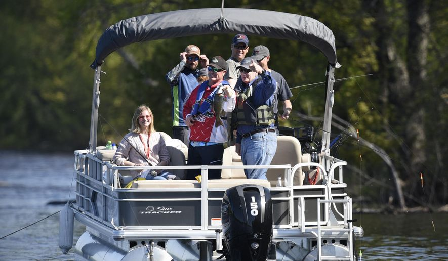 Gov. Mark Dayton gives the thumbs-up sign after catching a 17.5-inch smallmouth bass during the 2017 Minnesota Governor's Fishing Opener Saturday, April 13, 2017, on the Mississippi River in St. Cloud, Minn. (Dave Schwarz/The St. Cloud Times via AP)