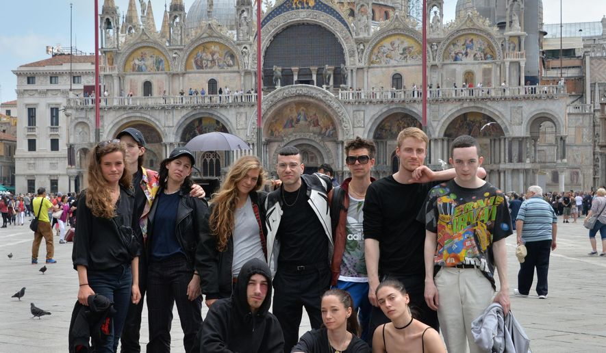 The performers team of 'Faust', by German artist Anne Imhof, winner of the Golden Lion for Best National Pavillion award at the 57th Venice Biennale contemporary art show, pose in St. Mark's Square in Venice, Italy, Saturday, May, 13, 2017. The Biennale made the awards Saturday as the oldest contemporary art fair opened its six-month stint. (Andrea Merola/ANSA via AP)