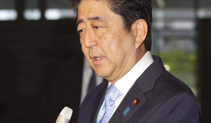 Japanese Prime Minister Shinzo Abe speaks to the media at the prime minister's official residence in Tokyo shortly after learning that North Korea conducted a missile launch test, Sunday morning, May 14, 2017. Japan's Chief Cabinet Secretary Yoshihide Suga said the missile test-fired by North Korea flew 800 kilometers (500 miles) for about 30 minutes and landed in the Sea of Japan, but not inside Japan's exclusive economic zone. (Hiroki Yamauchi/Kyodo News via AP)