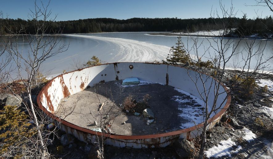 In this Wednesday, Dec. 21, 2016 photo, a deteriorating tank sits on the site of the Callahan Mine in Brockville, Maine. The former open pit copper and zinc mine is now a federal Superfund site. Mining companies that once pursued precious metals have abandoned half a million mines across the country and, thanks to decades of lax regulations, left the bill to taxpayers. (AP Photo/Robert F. Bukaty)
