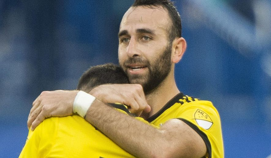 Columbus Crew's Justin Meram hugs teammate Artur after following an MLS soccer game against the Montreal Impact in Montreal, Saturday, May 13, 2017. Meram scored three goals in their 3-2 win. (Graham Hughes/The Canadian Press via AP)
