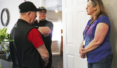 ADVANCE FOR WEEKEND MAY 13-14, 2017 AND THEREAFTER - In this May 5, 2017 photo, Kristina Fitzgerald, resident manager of Freedom House, talks with John Walker and Mike Meredith of the VFW during the sober living home's open house in Soldotna, Alaska. Freedom House is an eight-bed, faith-based transitional living home for women recovering from addictions. (Megan Pacer/Peninsula Clarion via AP)