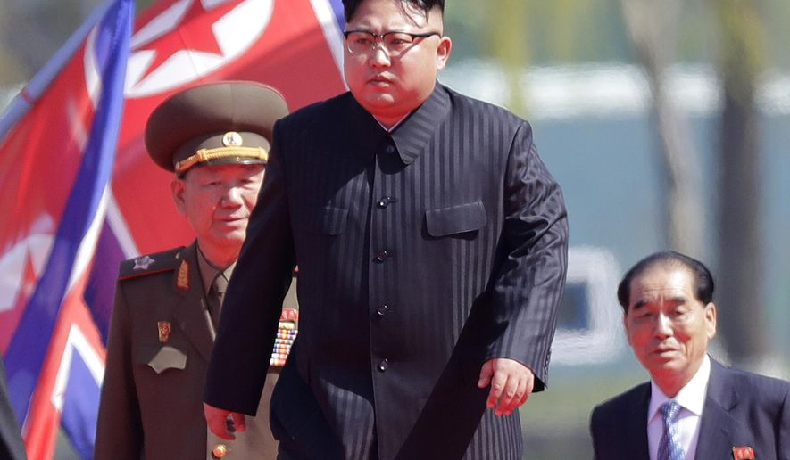 FILE - In this April 13, 2017 file photo, North Korean leader Kim Jong Un, center,  is accompanied by Pak Pong Ju, right, Hwang Pyong So, second left, as he arrives for the official opening of the Ryomyong residential area, in Pyongyang, North Korea.  Pyongyang will seek the extradition of anyone involved in what it says was a CIA-backed plot to kill leader Kim Jung Un April, 2017,  with a biochemical poison, a top North Korean foreign ministry official said Thursday, May 11, 2017.(AP Photo/Wong Maye-E, File)