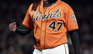San Francisco Giants starting pitcher Johnny Cueto pumps his fist after getting Cincinnati Reds' Zack Cozart to ground out for the last out of the top of the fifth inning of a baseball game Friday, May 12, 2017, in San Francisco. (AP Photo/Marcio Jose Sanchez)