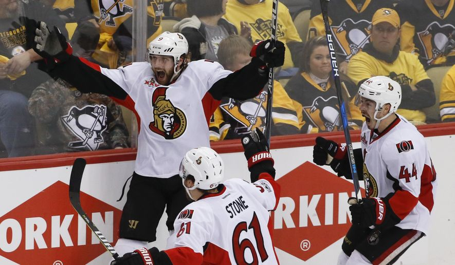 Ottawa Senators' Bobby Ryan, left, celebrates with teammates Mark Stone (61) and Jean-Gabriel Pageau (44) after scoring the game-winning goal against the Pittsburgh Penguins during the overtime period of Game 1 of the Eastern Conference final in the NHL hockey Stanley Cup playoffs, Saturday, May 13, 2017, in Pittsburgh. Ottawa won 2-1 in overtime. (AP Photo/Gene J. Puskar)
