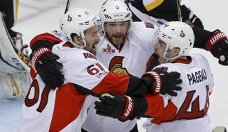Ottawa Senators' Jean-Gabriel Pageau (44) celebrates with teammates Mark Stone (61) and Bobby Ryan (9) after scoring against the Pittsburgh Penguins during the first period of Game 1 of the Eastern Conference final in the NHL hockey Stanley Cup playoffs, Saturday, May 13, 2017, in Pittsburgh. (AP Photo/Gene J. Puskar)