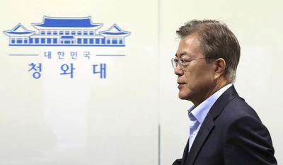 "South Korean President Moon Jae-in arrives to preside over a meeting of the National Security Council at the presidential Blue House in Seoul, South Korea, May 14, 2017. North Korea on Sunday test-launched a ballistic missile that landed in the Sea of Japan, the South Korean, Japanese and U.S. militaries said. The launch is a direct challenge to the new South Korean president elected four days ago and comes as U.S., Japanese and European navies gather for joint war games in the Pacific. The signs read "" The Presidential Blue House"". (Yonhap via AP)"