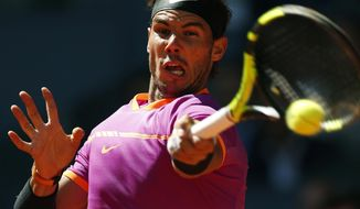 Rafael Nadal of Spain plays a return to Novak Djokovic of Serbia during their mens semifinal tennis match at the Madrid Open tennis tournament in Madrid, Spain, Saturday, May 13, 2017. (AP Photo/Francisco Seco)