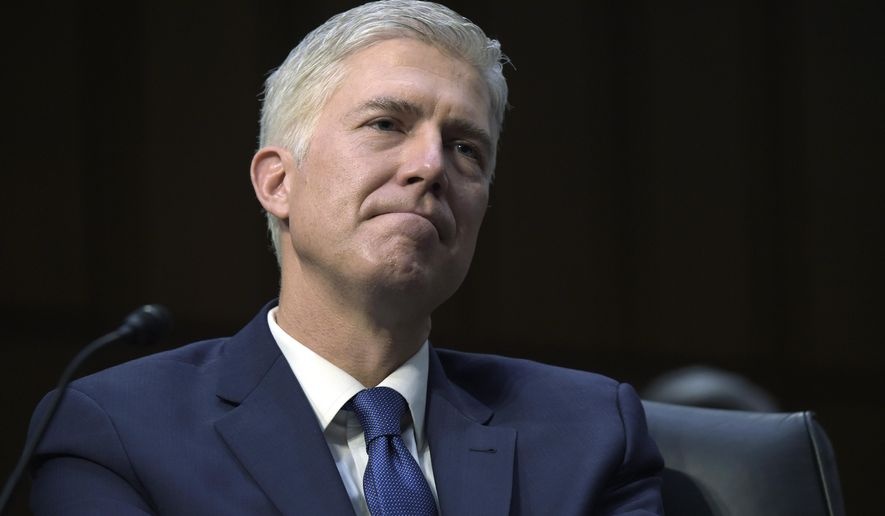 File - In this March 20, 2017 file photo, Supreme Court Justice nominee Neil Gorsuch listens to opening statements on Capitol Hill in Washington, during his confirmation hearing before the Senate Judiciary Committee.  His earlier dissent as an appeals court judge in a case involving a New Mexico seventh-grader who was handcuffed and arrested after his teacher said the student had disrupted gym class with fake burps, means he probably won't have any role in considering it, should it come before the high court. (AP Photo/Susan Walsh)