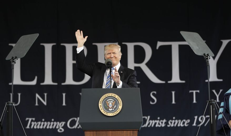 "In this file photo, President Donald Trump gives the commencement address for the Class of 2017 at Liberty University in Lynchburg, Va., Saturday, May 13, 2017. In testimony to Congress on Feb. 27, 2019, Mr. Trump's former attorney and ""fixer"" Michael Cohen said that the president directed him during the 2016 campaign to threaten legal action against the College Board should it release Mr. Trump's SAT scores. (AP Photo/Pablo Martinez Monsivais) **FILE**"
