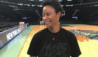 San Antonio Stars rookie coach Vickie Johnson prepares to talk to a reporter Friday, May 12, 2017, after her team practiced at Madison Square Garden in New York. Johnson will make her coaching debut on Saturday where she starred as a player for the Liberty for nine years. (AP Photo/Doug Feinberg)
