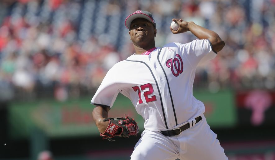 Washington Nationals relief pitcher Enny Romero throws in the eight inning of the first game of a doubleheader against the Philadelphia Phillies, Sunday, May 14, 2017, in Washington. (AP Photo/Mark Tenally)