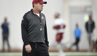 Washington Redskins head coach Jay Gruden looks on during an NFL football rookie minicamp, Saturday, May 13, 2017, in Ashburn, Va. (AP Photo/Nick Wass)