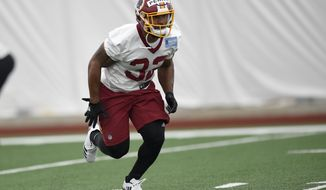 Washington Redskins running back Samaje Perine (32) runs during an NFL football rookie minicamp, Saturday, May 13, 2017, in Ashburn, Va. (AP Photo/Nick Wass)