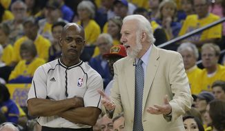San Antonio Spurs head coach Gregg Popovich, right, talks with referee Tom Washington during the first half of Game 1 of the NBA basketball Western Conference finals between the Golden State Warriors and the San Antonio Spurs in Oakland, Calif., Sunday, May 14, 2017. (AP Photo/Jeff Chiu)