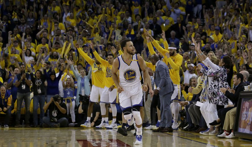 Golden State Warriors guard Stephen Curry (30) reacts after scoring against the San Antonio Spurs during the second half of Game 1 of the NBA basketball Western Conference finals in Oakland, Calif., Sunday, May 14, 2017. The Warriors won 113-111. (AP Photo/Jeff Chiu)