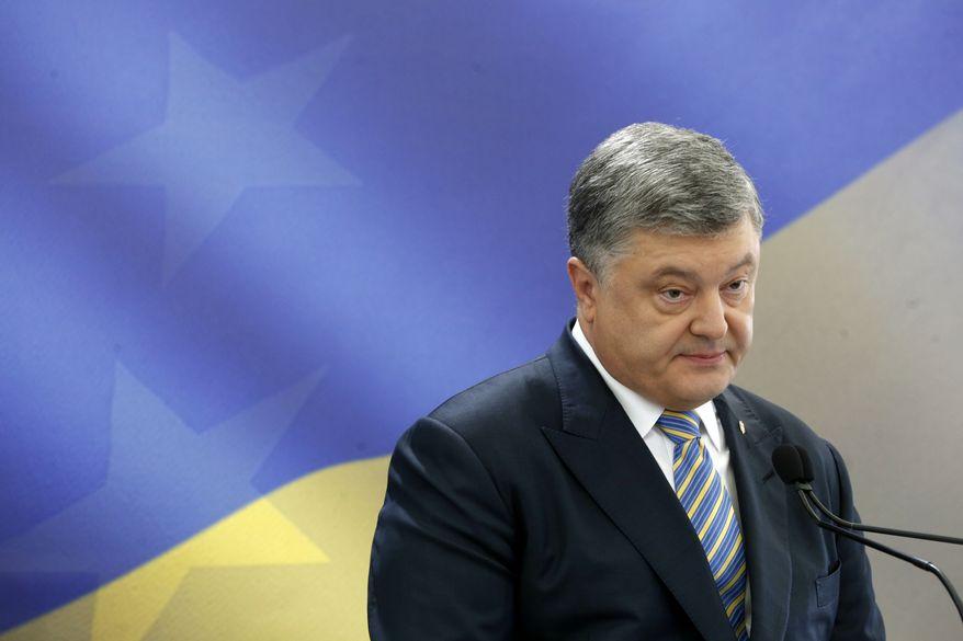 Ukrainian President Petro Poroshenko speaks during a news conference in Kiev, Ukraine, Sunday, May 14, 2017. (AP Photo/Sergei Chuzavkov)