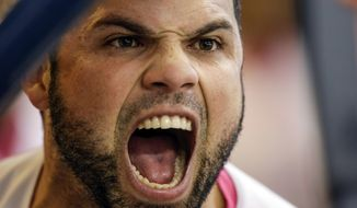 Milwaukee Brewers' Manny Pina reacts to his three-run home run off New York Mets' Addison Reed during the eighth inning of a baseball game Sunday, May 14, 2017, in Milwaukee. (AP Photo/Tom Lynn)