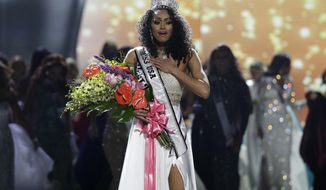 Miss District of Columbia USA Kara McCullough reacts after she was crowned the new Miss USA during the Miss USA contest Sunday, May 14, 2017, in Las Vegas. (AP Photo/John Locher)