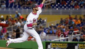 Miami Marlins' Justin Nicolino delivers a pitch during the first inning of a baseball game against the Atlanta Braves, Sunday, May 14, 2017, in Miami. (AP Photo/Wilfredo Lee)