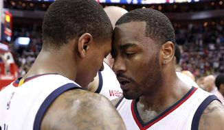 Washington Wizards guards Bradley Beal, left, and John Wall celebrate after Game 6 of the team's NBA basketball second-round playoff series against the Boston Celtics, Friday, May 12, 2017, in Washington. The Wizards won 92-91. (AP Photo/Alex Brandon)