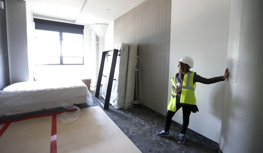 ADVANCE FOR USE SUNDAY, MAY 14 - In this May 2, 2017 photo, Kim DeGood talks about the progress at the Courtyard by Marriott hotel under construction in the Tech II building of TechWorks in Waterloo, Iowa, (Brandon Pollock/The Courier via AP)