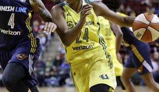 Seattle Storm's Jewell Loyd, right, drives as Indiana Fever's Candice Dupree defends in the second half of a WNBA basketball game Sunday, May 14, 2017, in Seattle. Loyd led all scorers with 27 points and the Storm won 87-82. (AP Photo/Elaine Thompson)