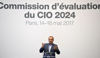 Patrick Baumann, president of the IOC Evaluation Commission for the 2024 Olympic Games addresses the IOC Evaluation Commission session in Paris, Sunday, May 14, 2017, as the International Olympic Committee visits Paris ahead of a the September vote for the 2024 Summer Olympics. (Franck Fife, Pool via AP)