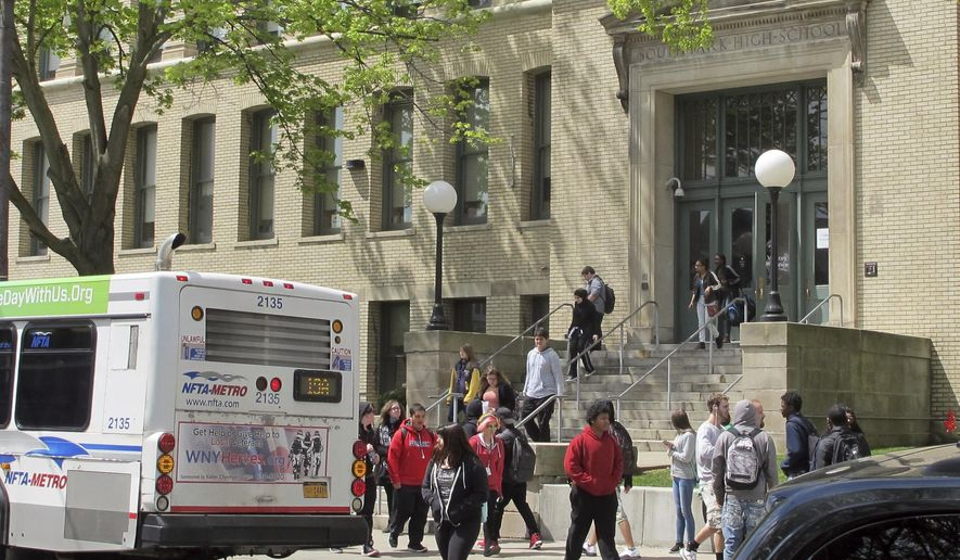 In this May 10, 2017 photo, students leave South Park High School in Buffalo, N.Y. The Medicaid changes being advanced as part of the health overhaul are sounding familiar alarms for school districts still getting their financial footing after the Great Recession. (AP Photo/Carolyn Thompson)