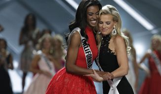 Miss California USA India Williams, left, and Miss Tennessee USA Allee-Sutton Hethcoat embrace after making the top 10 during the Miss USA contest Sunday, May 14, 2017, in Las Vegas. (AP Photo/John Locher)