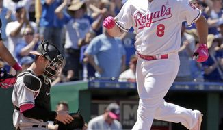 Kansas City Royals' Mike Moustakas (8) crosses the plate past Baltimore Orioles catcher Caleb Joseph after hitting a three-run home run during the fourth inning of a baseball game Sunday, May 14, 2017, in Kansas City, Mo. (AP Photo/Charlie Riedel)