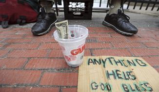 In this Wednesday, May 10, 2017 photo D. Rogers, a homeless man, panhandles for change in Portland, Maine. The city recently began a program to offer day jobs cleaning up parks and other light labor jobs to panhandlers for $10.68 an hour. (AP Photo/Robert F. Bukaty)