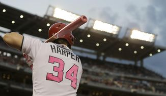 Washington Nationals' Bryce Harper warms up in the on-deck circled in the third inning of the second game of a doubleheader against the Philadelphia Phillies, Sunday, May 14, 2017, in Washington. (AP Photo/Mark Tenally) ** FILE **