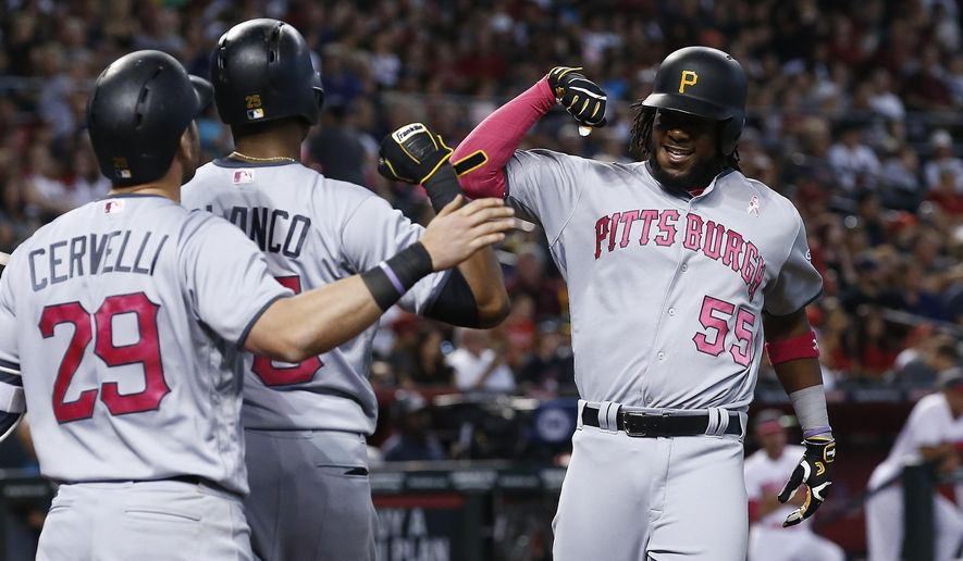 Pittsburgh Pirates' Josh Bell (55) celebrates his two-run home run against the Arizona Diamondbacks with Francisco Cervelli (29) and Gregory Polanco during the third inning of a baseball game Sunday, May 14, 2017, in Phoenix. (AP Photo/Ross D. Franklin)