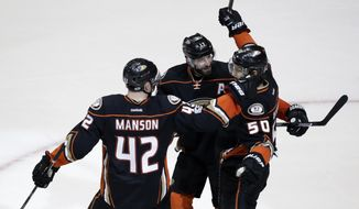 Anaheim Ducks' Antoine Vermette (50) celebrates with Josh Manson (42) and Ryan Kesler (17) after scoring a goal against the Nashville Predators during the third period of Game 2 of the Western Conference final in the NHL hockey Stanley Cup playoffs, Sunday, May 14, 2017, in Anaheim, Calif. The Ducks won 5-3. (AP Photo/Chris Carlson)