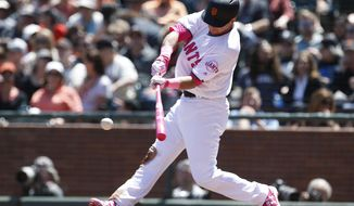 San Francisco Giants' Joe Panik (12) hits a single against the Cincinnati Reds during the fourth inning of a baseball game in San Francisco, Sunday, May 14, 2017. (AP Photo/ Tony Avelar)