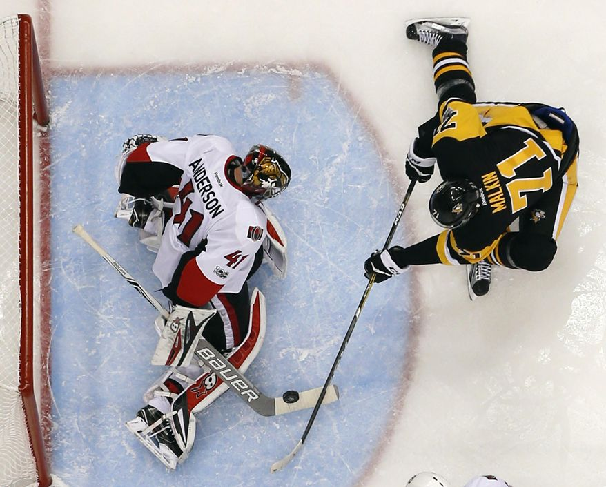 Ottawa Senators goalie Craig Anderson (41) stops a shot by Pittsburgh Penguins' Evgeni Malkin (71)during the second period of Game 1 of the Eastern Conference final in the NHL Stanley Cup hockey playoffs against the Pittsburgh Penguins in Pittsburgh, Saturday, May 13. 2017. The Senators won 2-1 in overtime. (AP Photo/Gene J. Puskar)