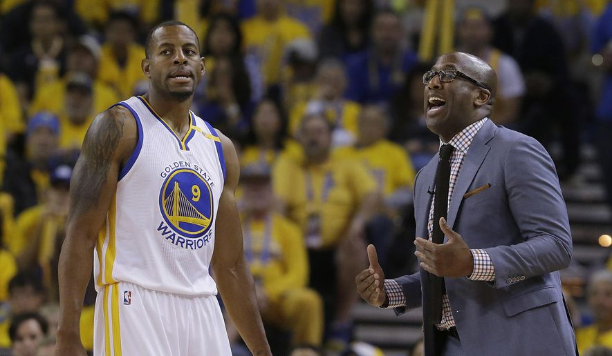 Golden State Warriors interim head coach Mike Brown, right, gestures next to forward Andre Iguodala (9) during the first half of Game 1 of the NBA basketball Western Conference finals against the San Antonio Spurs in Oakland, Calif., Sunday, May 14, 2017. (AP Photo/Jeff Chiu)