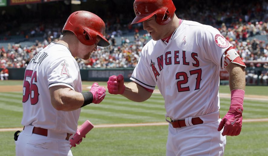 Los Angeles Angels' Mike Trout, right, celebrates his solo home run with Kole Calhoun during the first inning of a baseball game against the Detroit Tigers in Anaheim, Calif., Sunday, May 14, 2017. (AP Photo/Alex Gallardo)