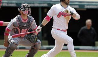 Cleveland Indians' Jason Kipnis watches his ball after hitting a three-run home run off Minnesota Twins' Adam Wilk in the third inning of a baseball game, Sunday, May 14, 2017, in Cleveland. Lonnie Chisenhall and Roberto Perez scored on the play. Minnesota Twins catcher Chris Gimenez watches. (AP Photo/Tony Dejak)