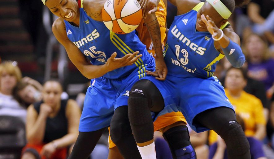 Dallas Wings forward Glory Johnson (25) and guard Karima Christmas-Kelly (13) collide while defended by Phoenix Mercury guard Shay Murphy (14) during a WNBA basketball game in Phoenix, Sunday, May 14, 2017. (Michael Chow/The Arizona Republic via AP)