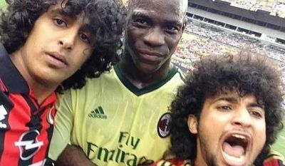 AC Milan striker Mario Balotelli joins fans for a selfie