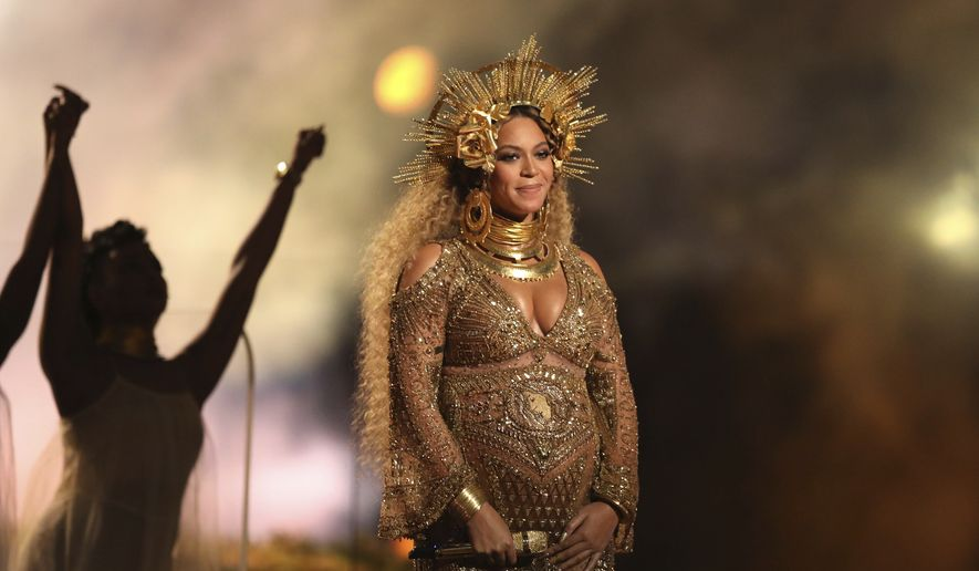 In this Feb. 12, 2017, file photo, Beyonce performs at the 59th annual Grammy Awards in Los Angeles. The pop star is nominated for seven awards at the 2017 BET Awards, the network told The Associated Press on Monday, May 15. The show will take place June 25 at the Microsoft Theater in Los Angeles. (Photo by Matt Sayles/Invision/AP, File)