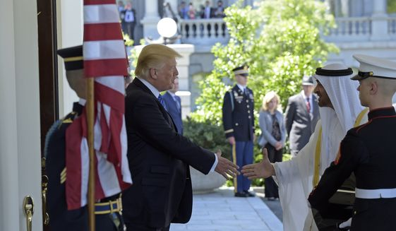 President Donald Trump welcomes Abu Dhabi's Crown Prince Sheikh Mohammed bin Zayed Al Nahyan to the White House in Washington, Monday, May 15, 2017. (AP Photo/Susan Walsh)