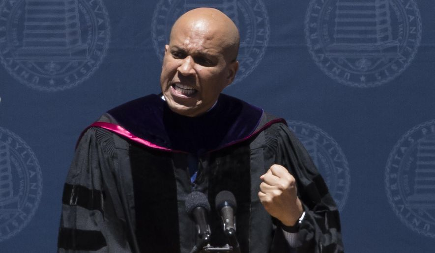 Sen. Cory Booker, D-N.J., speaks during the University of Pennsylvania commencement ceremony, in Philadelphia, Monday, May 15, 2017. The Democrat addressed the 5,000 graduates during Monday's ceremony in Philadelphia. (AP Photo/Matt Rourke)