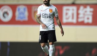 In this March 4, 2016 photo, Hebei China Fortune forward Ezequiel Lavezzi smiles as he plays in a Chinese Super League soccer match against Guangzhou R&F in Guangzhou in southern China's Guangdong Province. Argentine international Lavezzi has apologized to his Chinese fans in a statement dated Sunday, May 14, 2017, over a photo leaked online in which he pulls back his eyes with his fingers in a gesture widely seen as offensive. (Color China Photo via AP)