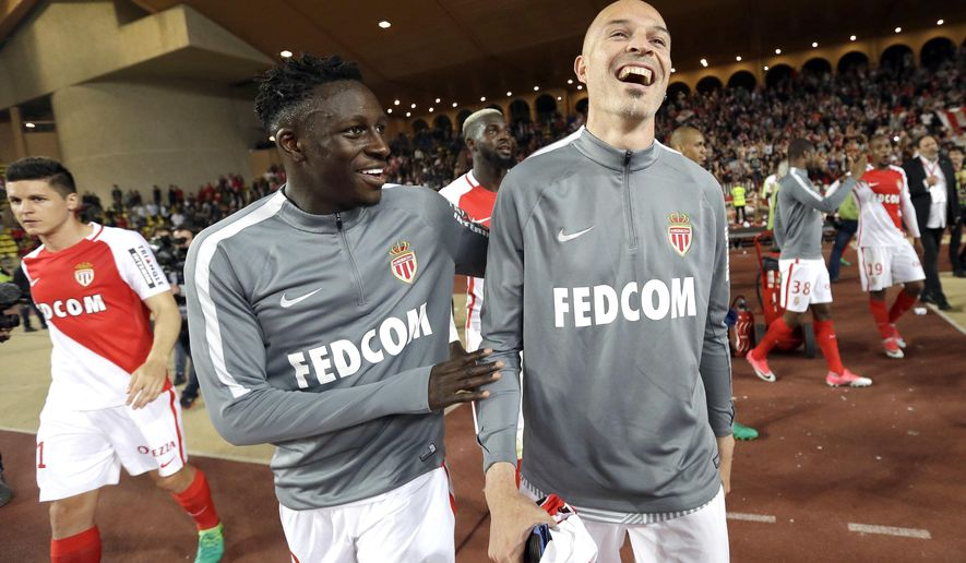 Monaco's Benjamin Mendy, left, Monaco's Andrea Raggi, react after defeating Lille during a League One soccer match between Monaco and Lille, at the Louis II stadium, in Monaco, Sunday, May, 14 2017. (AP Photo/Claude Paris)