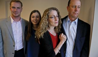 Timothy Piazza's family--his brother Michael Piazza, far left, mother Evelyn, second from right, his father James Piazza, far right, and his girlfriend Kaitlyn Tempalsky, second from left, pose following an interview on Monday May 15, 2017, in New York. Timothy Piazza, 19, died in February after he was put through a hazing ritual at his fraternity house at Penn State University and forced to drink dangerous amounts of alcohol in a short amount of time. (AP Photo/Bebeto Matthews)