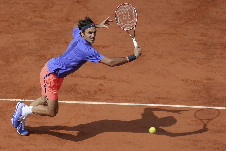 """FILE - In this June 2, 2016, file photo, Switzerland's Roger Federer makes a return against Switzerland's Stan Wawrinka during a quarterfinal match at the French Open tennis tournament in Paris, France. Roger Federer says he won't play in the French Open and instead prepare to play on grass and hard courts later this season. Federer posted a message entitled """"Roger to skip Roland Garros"""" on his website on Monday, May 15, 2017. (AP Photo/David Vincent, File)"""