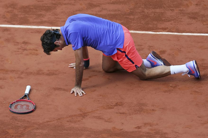 "FILE - In this June 2, 2015, file photo, Switzerland's Roger Federer gets up after slipping during a quarterfinal match against Switzerland's Stan Wawrinka at the French Open tennis tournament in Paris, France. Roger Federer says he won't play in the French Open and instead prepare to play on grass and hard courts later this season. Federer posted a message entitled ""Roger to skip Roland Garros"" on his website on Monday, May 15, 2017. (AP Photo/David Vincent, File)"